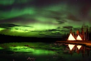 Aurora-Village-Yellowknife-Northwest-Territories-Canada-Aurora-Borealis-Northern-Lights-Summer-Two-Teepees-Reflection-Landscape-Colourful-perfect-Green-Hero