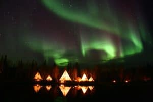 Aurora-Village-Yellowknife-Northwest-Territories-Canada-Aurora-Borealis-Northern-Lights-summer-Five-Teepees-Reflection-Landscape-Colourful-Green-Hero