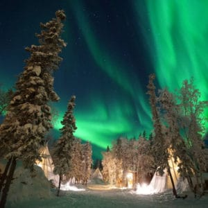 Instagram-Aurora-Village-Yellowknife-Northwest-Territories-Canada-Aurora-Borealis-Northern-Lights-winter-wonderland-white-blue-sky-teepees-hero-insta