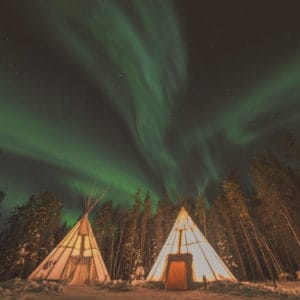 Instagram-Aurora-above-teepee-Village-yellowknife-forest-where-northwest-territories-chris