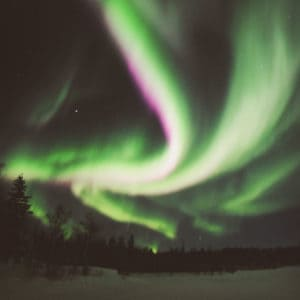 Instagram-Aurora-above-teepee-Village-yellowknife-forest-where-northwest-territories-pink